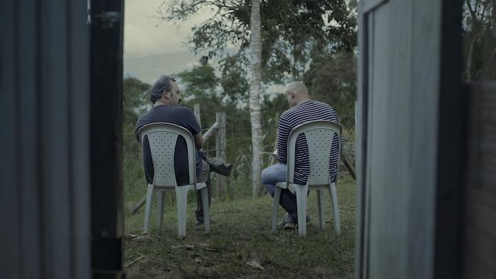 Iván Guarnizo con exguerrillero de las FARC